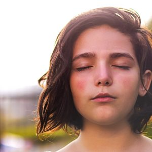 A girl breathing slowly during breathing programme