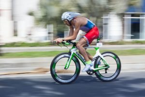 Brian Murphy, the owner of YourBreath, cycling on the sports bike