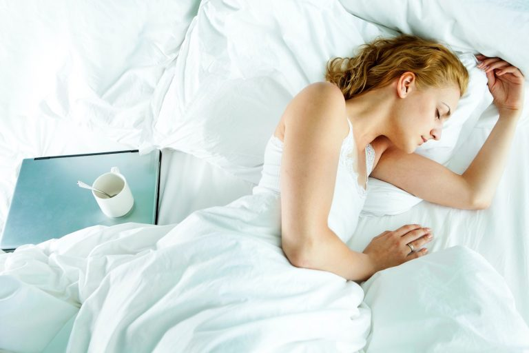 A woman sleeping well after taking a breathing programme at YourBreath