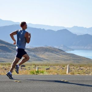 A man running in the mountains during Breathing for Sports Performance training at YourBreath