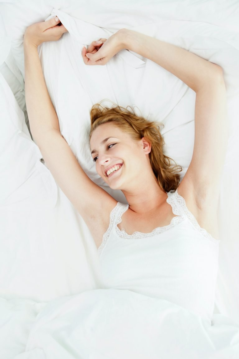 A happy woman after a good night's sleep