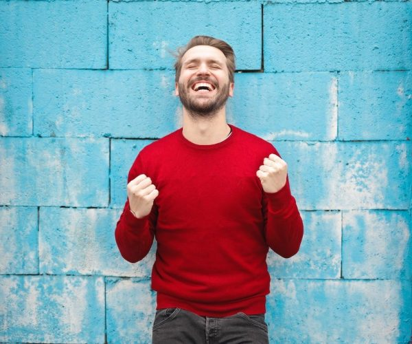 Happy man after taking breathing courses online