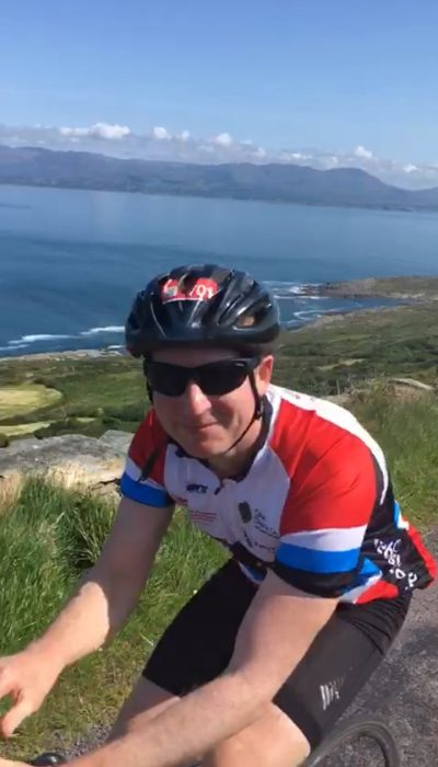 Brian Murphy cycling in the mountains to show healthy breathing